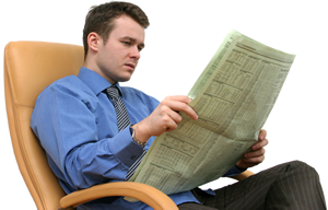 Photograph of a man reading a newspaper